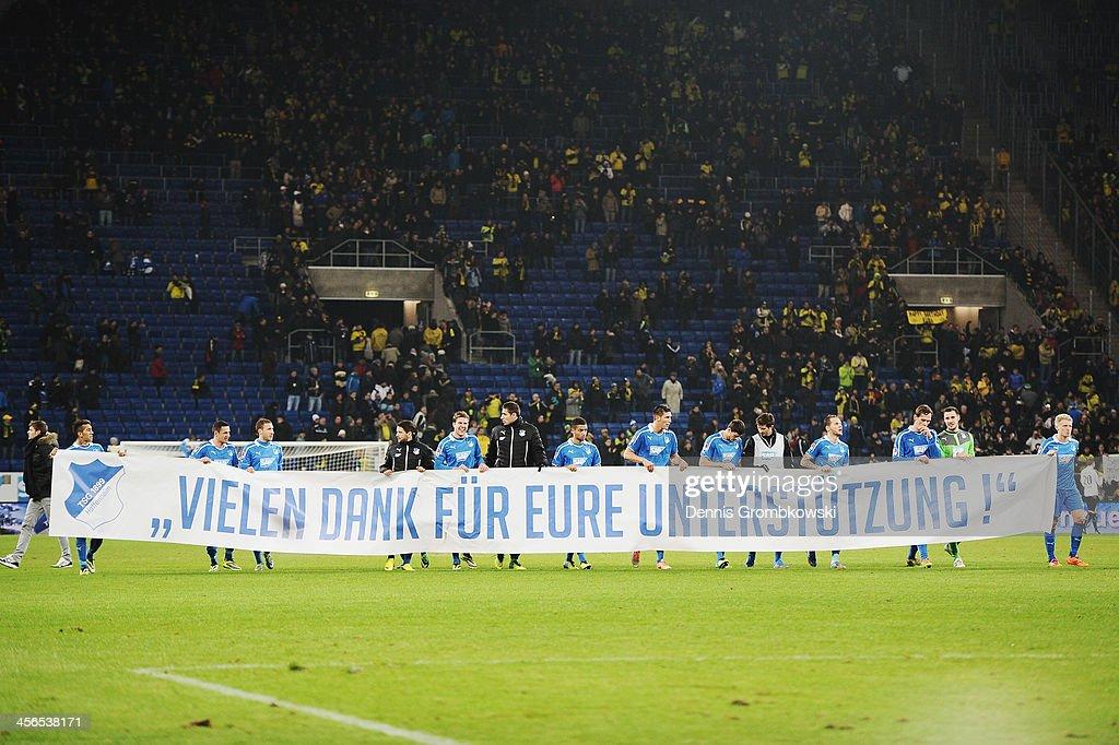 Hoffenheim players show a banner after the Bundesliga match between 1899 Hoffenheim and Borussia Dortmund at Rhein-Neckar-Arena on December 14, 2013 in Sinsheim, Germany.