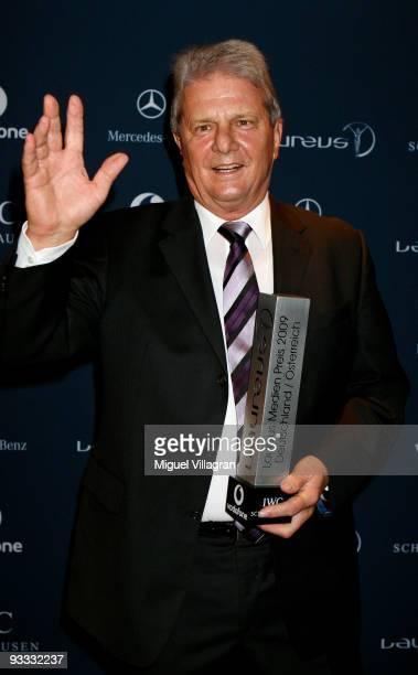 Hoffenheim sponsor Dietmar Hopp holds the Laureus Media Award in his hand on November 23 2009 in Kitzbuhel Austria