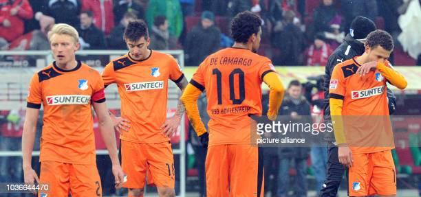 Hoffenheim's Andreas Beck Joselu Igor de Camargo and Roberto Firmino look disappointed after the Bundesliga soccer match between FC Augsburg and TSG...