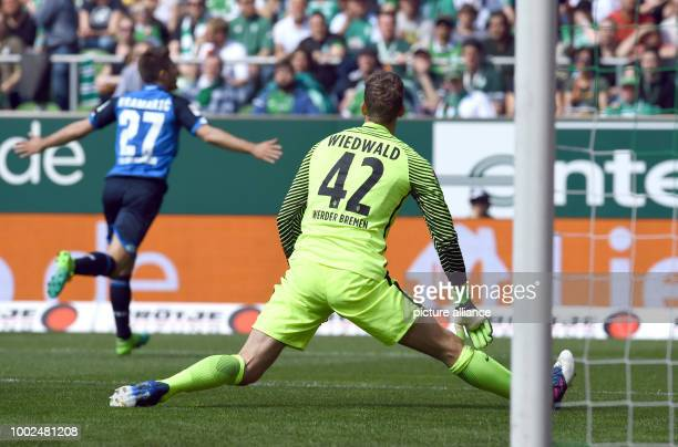 Hoffenheim's Andrej Kramaric celebrates his 02 goal next to Bremen's goalkeeper Felix Wiedwald during the German Bundesliga soccer match between...
