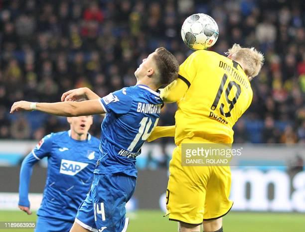 Hoffenheim's Austraian midfielder Christoph Baumgartner and Dortmund's German forward Julian Brandt vie for the ball during the German First division...
