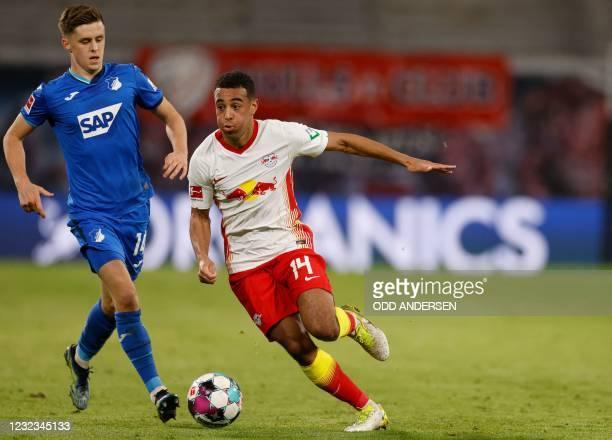 Hoffenheim's Austrian midfielder Christoph Baumgartner and Leipzig's US midfielder Tyler Adams vie for the ball during the German first divison...
