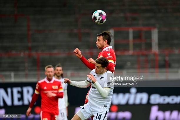Hoffenheim's Austrian midfielder Christoph Baumgartner and Union Berlin's Danish forward Marcus Ingvartsen vie for the ball during the German first...