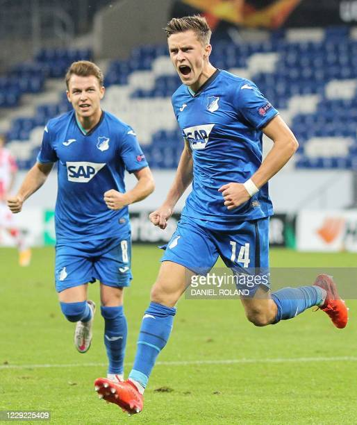 Hoffenheim's Austrian midfielder Christoph Baumgartner celebrates scoring the opening goal with his teammates during the UEFA Europa League group L...