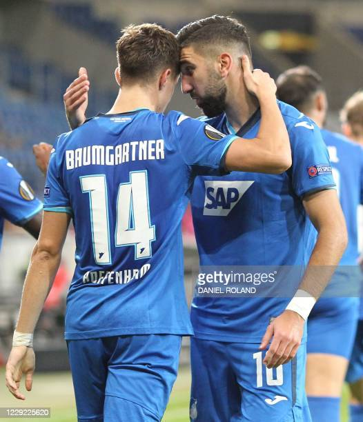 Hoffenheim's Austrian midfielder Christoph Baumgartner celebrates scoring the opening goal with his teammate Hoffenheim's Israeli forward Munas...