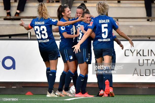 Hoffenheim's Belgian forward Tina Lea De Caigny is celebrated by teammates for scoring the 0-1 during the UEFA Women's Champions League football...