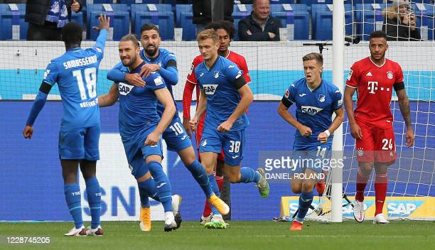 Hoffenheim's Bosnian defender Ermin Bicakcic celebrates with teammates scoring the opening goal during the German first division Bundesliga football...
