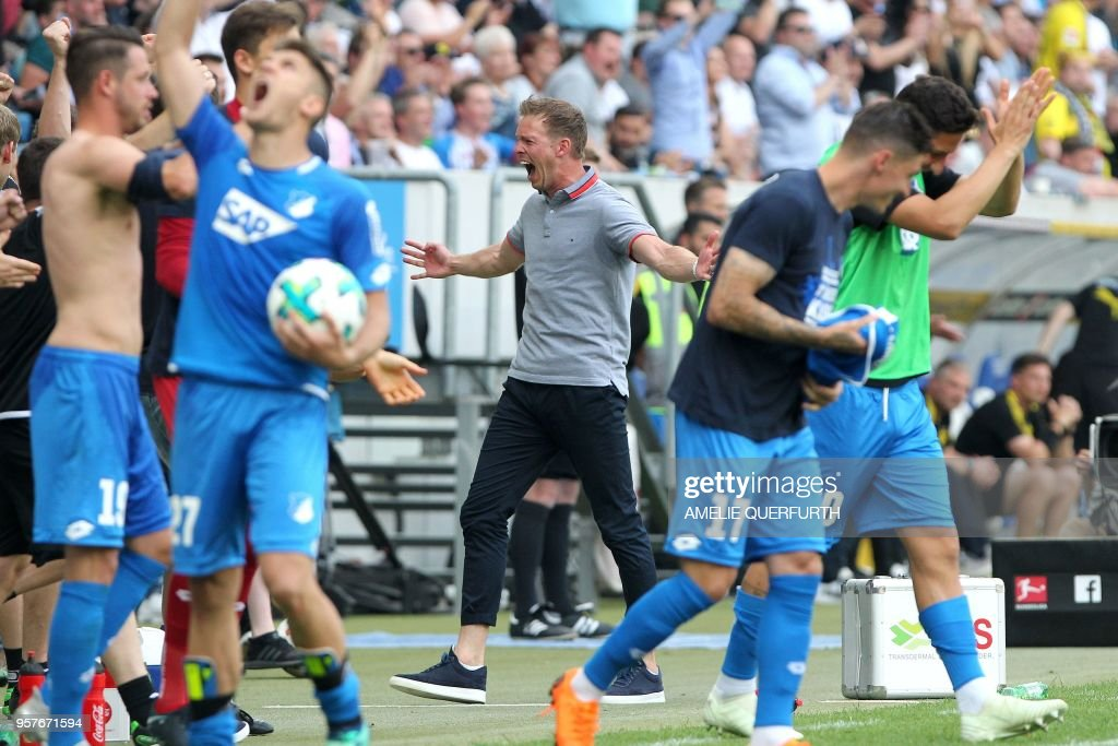 Hoffenheim's coach Julian Nagelsmann reacts at the end of the German first division Bundesliga football match TSG 1899 Hoffenheim vs Borussia Dortmund in Sinsheim, southern Germany, on May 12, 2018. - Hoffenheim won 3-1. (Photo by Amelie QUERFURTH / AFP)