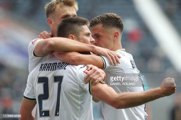 Hoffenheim's Croatian forward Andrej Kramaric celebrates after scoring a goal with Hoffenheim's Austrian defender Stefan Posch and Hoffenheim's...