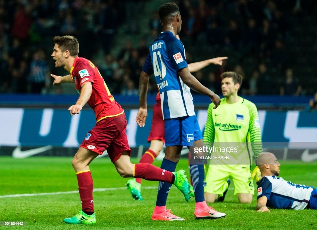 Hoffenheim´s Croatian forward Andrej Kramaric (L) celebrates scoring his side's 3rd goal during the German First division Bundesliga football match Hertha Berlin v Hoffenheim at the Olympic Stadium in Berlin, on March 31, 2017. / AFP PHOTO / Odd