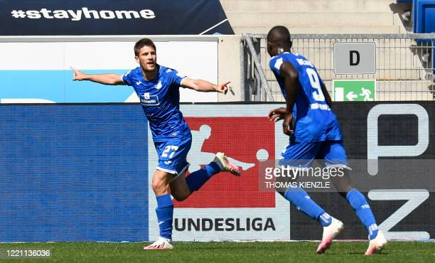 Hoffenheim's Croatian forward Andrej Kramaric celebrates with Hoffenheim's Togolese forward Ihlas Bebou after scoring the 2-0 during the German first...