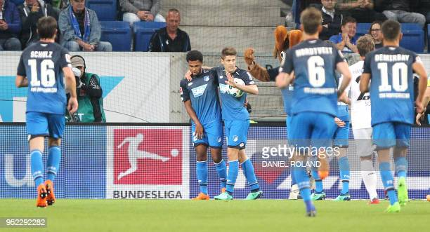 Hoffenheim's Croatian forward Andrej Kramaric is congratulated by Hoffenheims's German midfielder Serge Gnabry and other teammates after scoring a...