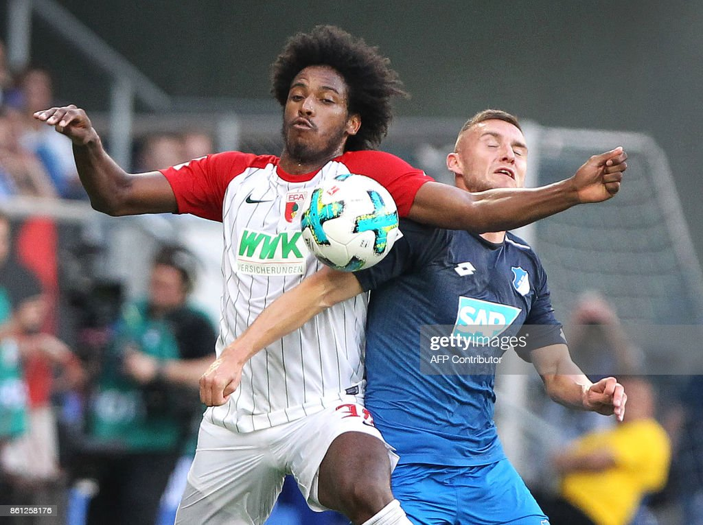 Hoffenheim's Czech defender Pavel Kaderabek (R) and Augsburg's Brazilian midfielder Caiuby vie for the ball during the German First division Bundesliga football match TSG 1899 Hoffenheim vs FC Augsburg in Sinsheim, southwestern Germany, on October 14, 2017. / AFP PHOTO / Amelie