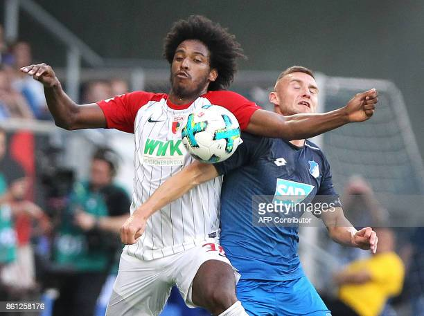 Hoffenheim's Czech defender Pavel Kaderabek and Augsburg's Brazilian midfielder Caiuby vie for the ball during the German First division Bundesliga...