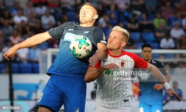 Hoffenheim's Czech defender Pavel Kaderabek and Augsburg's German defender Philipp Max vie for the ball during the German First division Bundesliga...