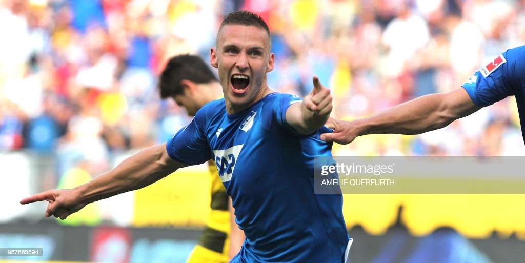 Hoffenheim's Czech defender Pavel Kaderabek celebrates after scoring the 3-1 during the German first division Bundesliga football match TSG 1899 Hoffenheim vs Borussia Dortmund in Sinsheim, southern Germany, on May 12, 2018. (Photo by Amelie QUERFURTH / AFP)