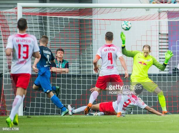 Hoffenheim's Czech defender Pavel Kaderabek scores the third goal past Leipzig's Hungarian goalkeeper Peter Gulacsi during the German first division...