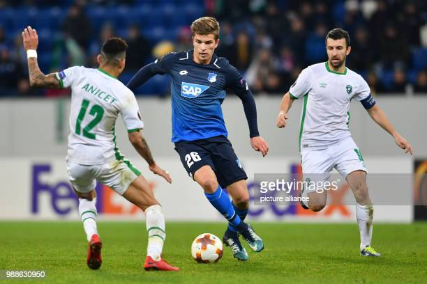 Hoffenheim's David Otto and Razgrad's Anicet Abel and Svetoslav Dyakov in action during the Europa League group C soccer match between 1899...
