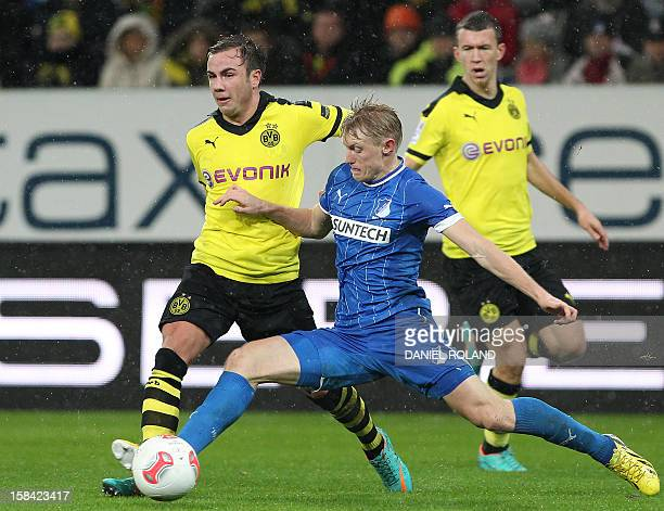 Hoffenheim's defender Andreas Beck and Dortmund's midfielder Mario Goetze vie for the ball during the German first division Bundesliga football match...