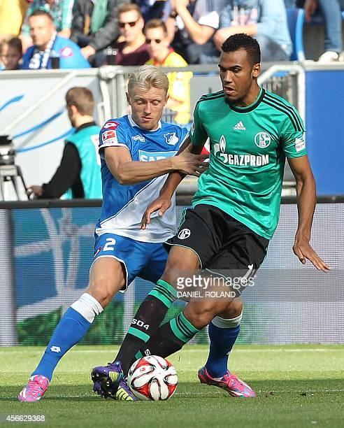 Hoffenheim's defender Andreas Beck and Schalke's Cameroonian forward Eric Maxim ChoupoMoting vie for the ball during the German first division...