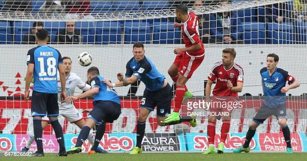 Hoffenheim's defender Niklas Suele scores the 1-2 own goal during the German First division Bundesliga football match between TSG Hoffenheim and FC...