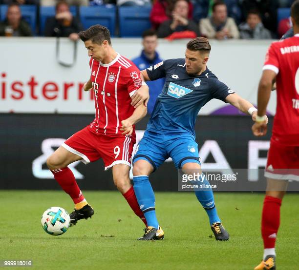 Hoffenheim's Ermin Bicakcic and Munich's Robert Lewandowski in action during the German Bundesliga soccer match between 1899 Hoffenheim and Bayern...