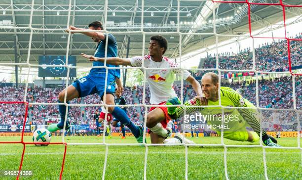 Hoffenheim's forward Mark Uth scores the first goal next to Leipzig's Brazilian defender Bernardo Fernandes da Silva Junior and Hungarian goalkeeper...