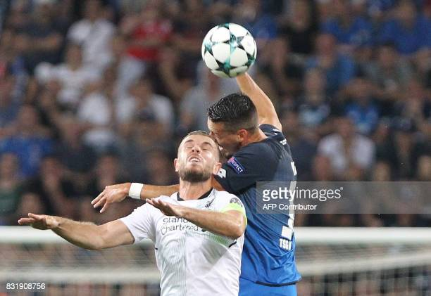 Hoffenheim's forward Sandro Wagner and Liverpool's English midfielder Jordan Henderson vie for the ball during the Champions League football...