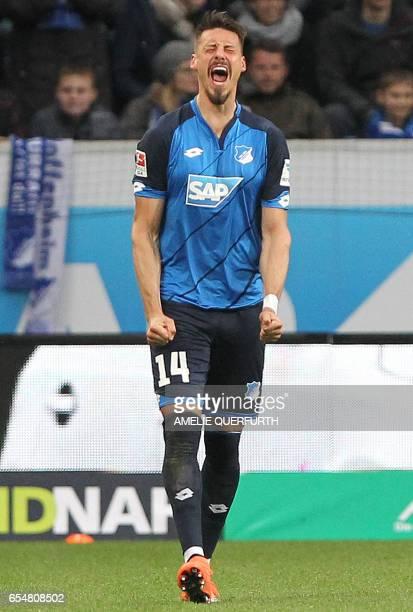 Hoffenheim's forward Sandro Wagner celebrates scoring the 10 during the German First division Bundesliga football match TSG 1899 Hoffenheim vs Bayer...
