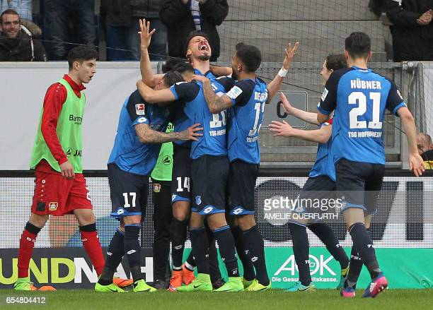 Hoffenheim's forward Sandro Wagner celebrates scoring the 10 vie for the ball during the German First division Bundesliga football match TSG 1899...