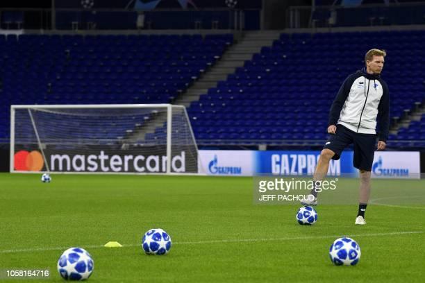 Hoffenheim's German coach Julian Nagelsmann looks on during a training session at the Parc Olympique Lyonnais stadium in Decines-Charpieu,...