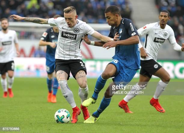 Hoffenheim's German defender Kevin Akpoguma and Frankfurt's German midfielder Marius Wolf vie for the ball during the German First division...