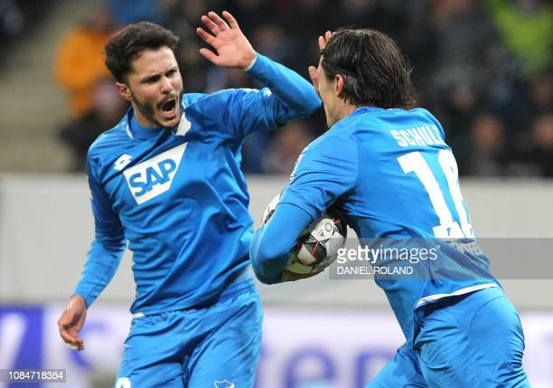Hoffenheim's German defender Nico Schulz celebrates with his teammates after scoring the 12 goal during the German First division Bundesliga football...