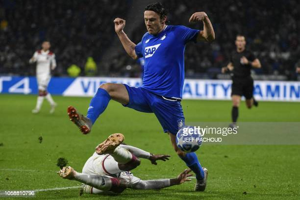 Hoffenheim's German defender Nico Schulz is tackled by Lyon's Brazilian defender Marcelo during the UEFA Champions League Group F football match...