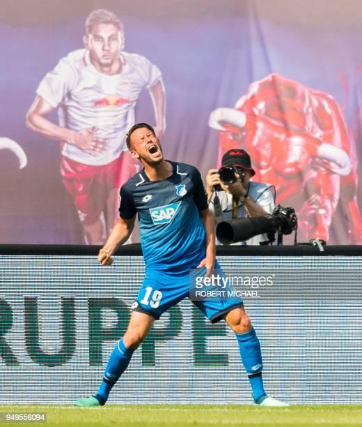 Hoffenheim's German forward Mark Uth celebrates scoring during the German first division Bundesliga football match between RB Leipzig and TSG...
