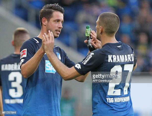 Hoffenheim's German forward Mark Uth is congratulated by Hoffenheim's Croatian forward Andrej Kramaric after scoring the 21 during the German First...