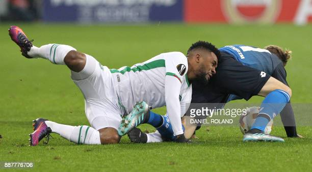 Hoffenheim's German forward Robin Hack and Ludogorets' Cicinho vie for the ball during the UEFA Europa League group C football match TSG 1899...