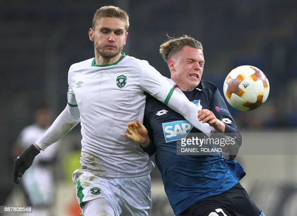 Hoffenheim's German forward Robin Hack and Ludogorets' Igor Plastun vie for the ball during the UEFA Europa League group C football match TSG 1899...