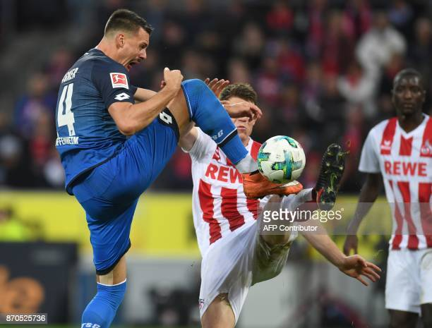 Hoffenheim's German forward Sandro Wagner and Cologne's German defender Dominique Heintz vie for the ball during the German first division Bundesliga...