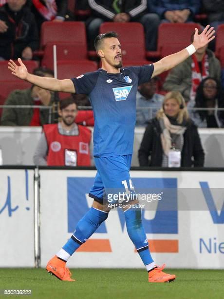 Hoffenheim's German forward Sandro Wagner celebrate scoring during the German first division Bundesliga football match 1 FVS Mainz 05 v TSG...