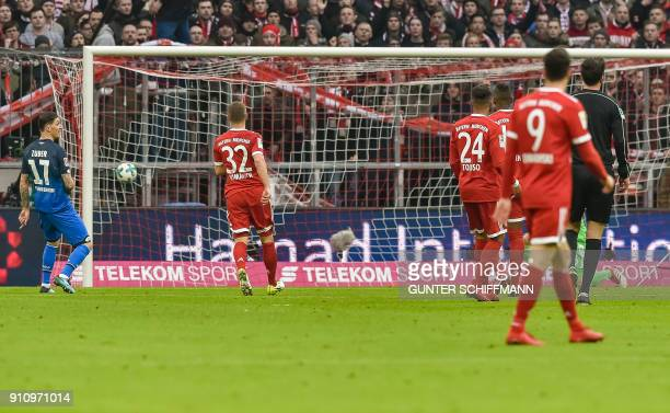 Hoffenheim's German forward Serge Gnabry scores the second goal during the German first division Bundesliga football match Bayern Munich v TSG 1899...