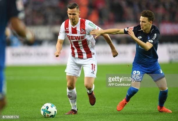 Hoffenheim's German midfielder Dennis Geiger and Cologne's Polish defender Pawel Olkowski vie for the ball during the German first division...
