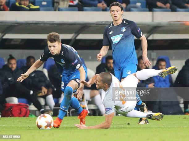 Hoffenheim's German midfielder Dennis Geiger and Istanbul Basaksehir's midfielder from Switzerland Gokhan Inler vie for the ball during the UEFA...