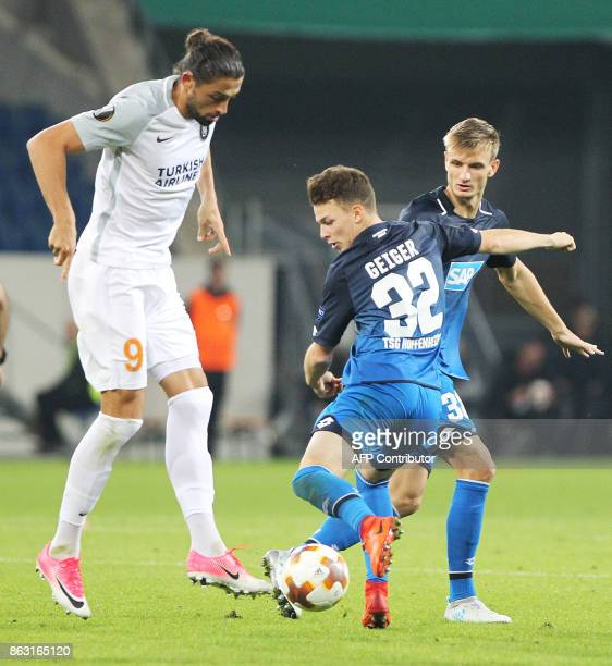 Hoffenheim's German midfielder Dennis Geiger and Istanbul Basaksehir's forward from Turkey Mehmet Batdal vie for the ball during the UEFA Europa...