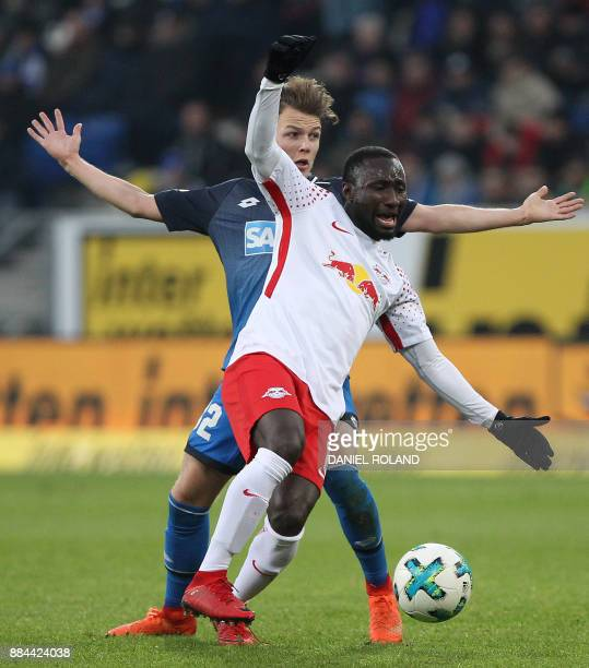 Hoffenheim's German midfielder Dennis Geiger and Leipzig's Guinean midfielder Naby Keita vie for the ball during the German First division Bundesliga...