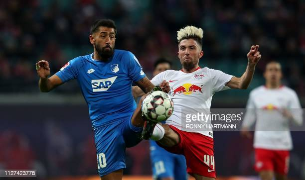 Hoffenheim's German midfielder Kerem Demirbay and Leipzig's Slovanian midfielder Kevin Kampl vie for the ball during the German first division...