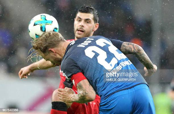 Hoffenheim's German midfielder Kevin Vogt and Leverkusen's German forward Kevin Volland vie for the ball during the German First division Bundesliga...