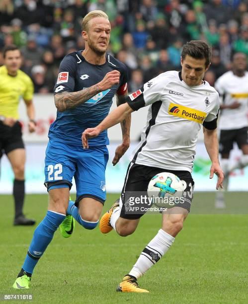Hoffenheim's German midfielder Kevin Vogt and Moenchengladbach's German midfielder Jonas Hofmannvie for the ball during the German First division...