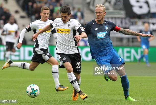 Hoffenheim's German midfielder Kevin Vogt and Moenchengladbach's German midfielder Jonas Hofmann vie for the ball during the German First division...