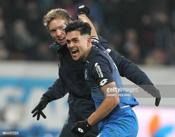 Hoffenheim's German midfielder Nadiem Amiri and Hoffenheim's German head coach Julian Nagelsmann celebrates the 30 during the German First division...
